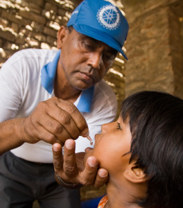 Rotarian Om Prakash Jaiswal, of the Rotary Club of Birgunj, Nepal, administers the polio vaccine to children in rural neighborhoods near Birgunj, Nepal, during a subnational polio immunization day. Border towns with little regulation like Birgunj create high risk of the spread of the poliovirus. Subnational immunization days take place more often than larger annual events and target strategic locations based on research by Rotary's polio eradication partners, the World Health Organization, UNICEF, and the U.S. Centers for Disease Control.